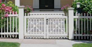 White picket fence with wood fence gate